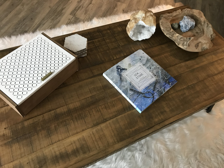 Crystal home decor displayed on a wooden coffee table